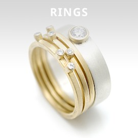square gold stacking rings with scattered diamonds