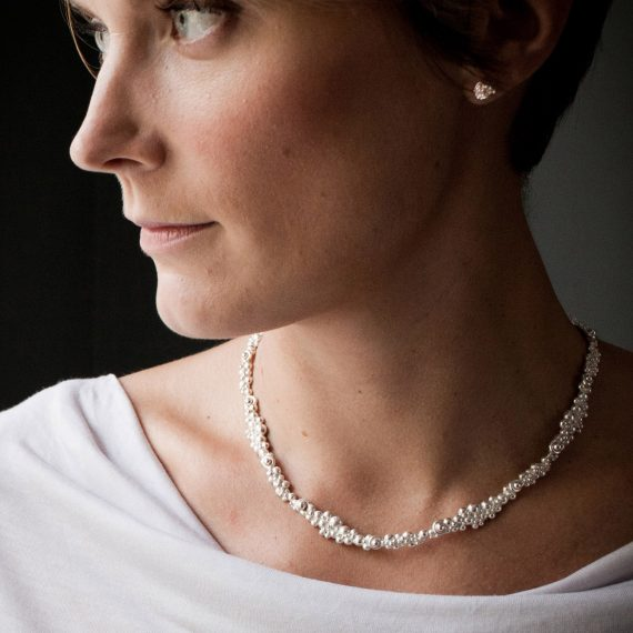 silver_beaded_necklace_continuous_lifestyle