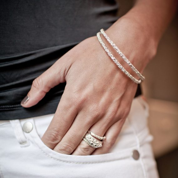 silver beaded narrow bangles on model