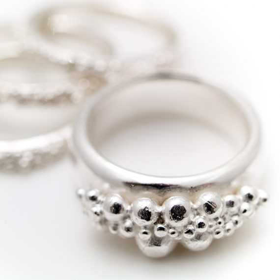 Silver wide beaded ring