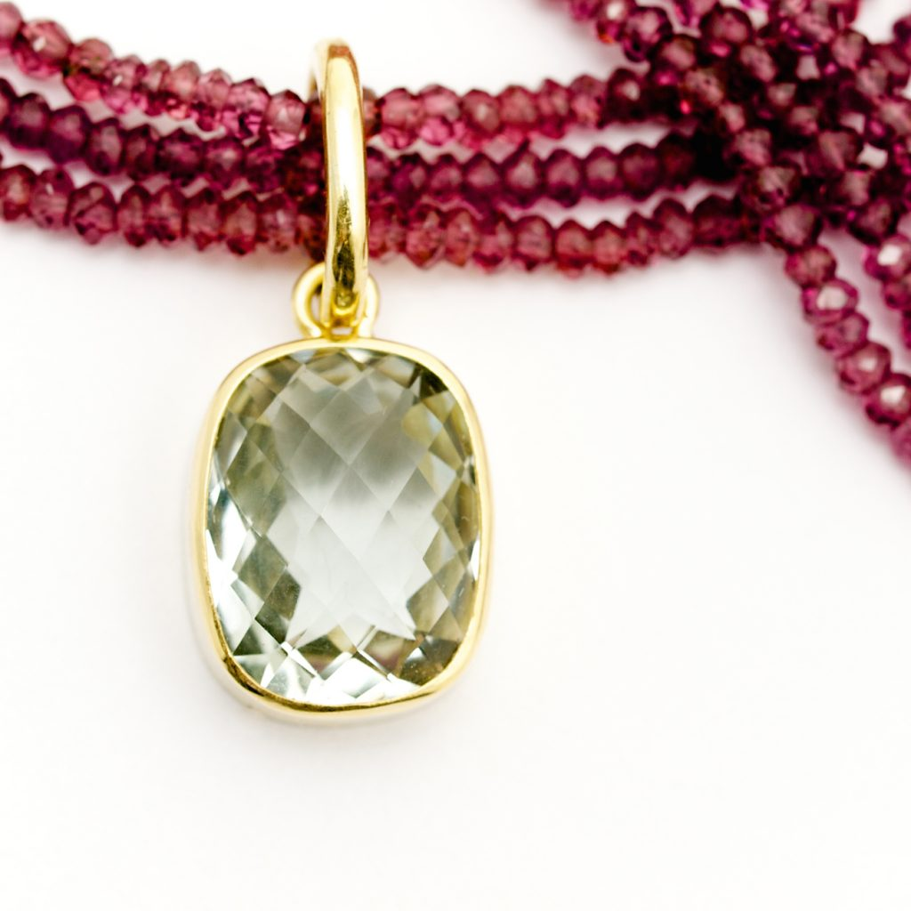 Rhodelite bead necklace with Green Amethyst set in 18ct yellow gold
