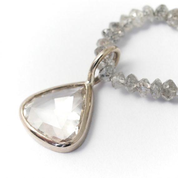 Diamond rose cut drop diamond on a string of diamond beads
