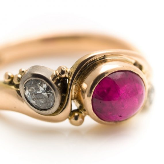 commission 18ct rose gold art deco ring with cabochon ruby and diamonds