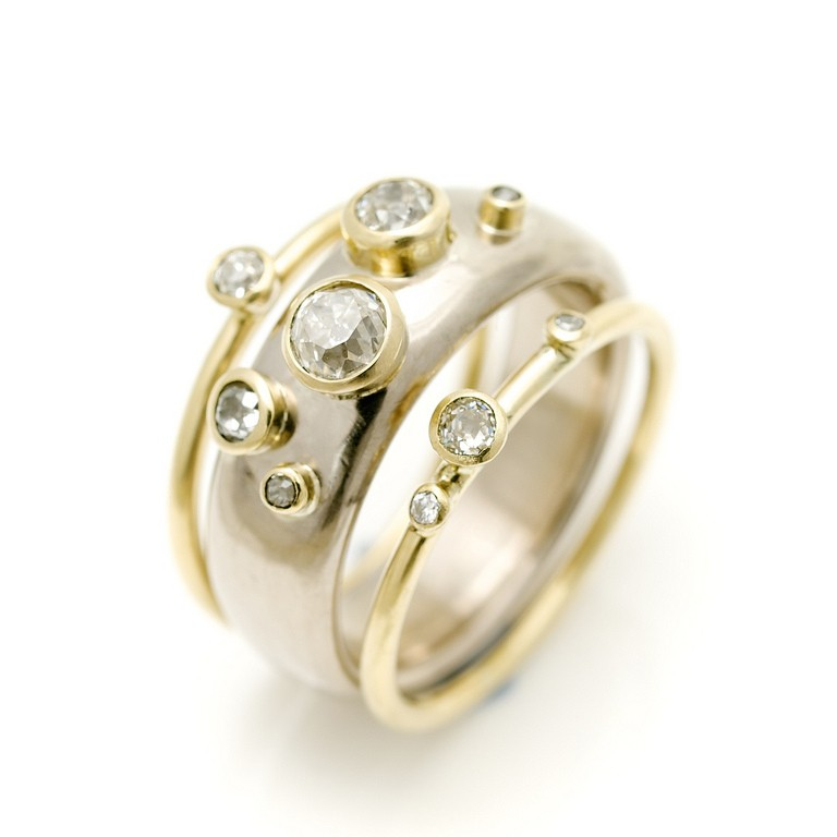 18ct wide gold ring with scattered diamonds and narrow 18ct gold rings