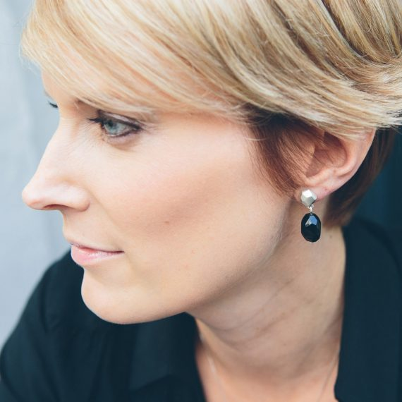 silver flint geometric stud earring with onyx on model