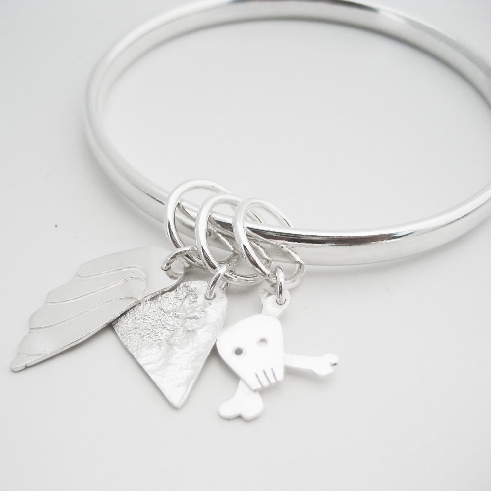 student project silver bangle with 3 charms