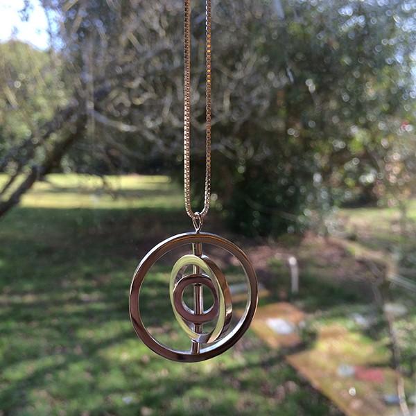 Silver gyroscopic pendant