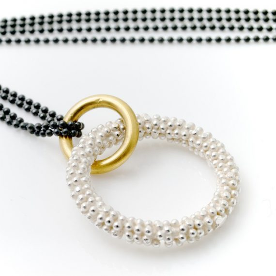 silver beaded circular necklace with gold plate and oxydised ball chain