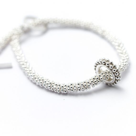 Silver decorative bead bracelet with beaded ring charm