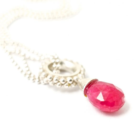 silver beaded ring pendant with a pink ruby drop