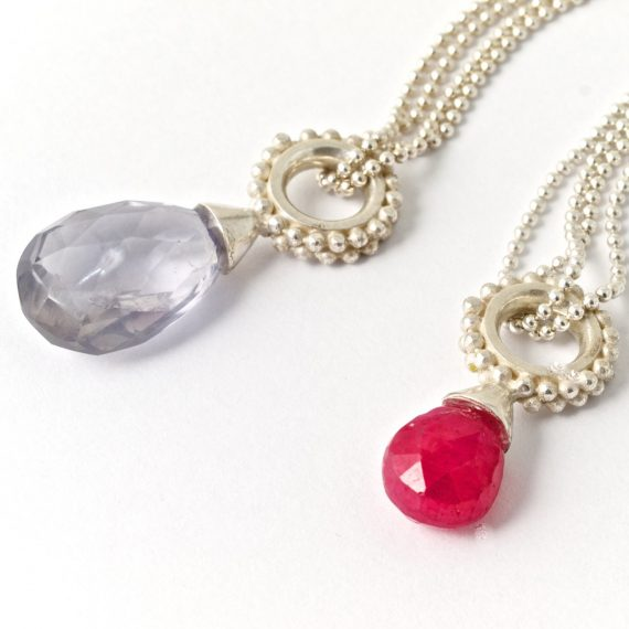 Silver beaded ring pendant with a drop ruby or Iolite drop