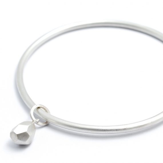 Silver bangle with Flint drop charm