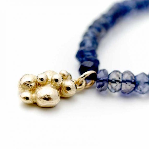 Blue Iolite bead necklace with gold beaded charm