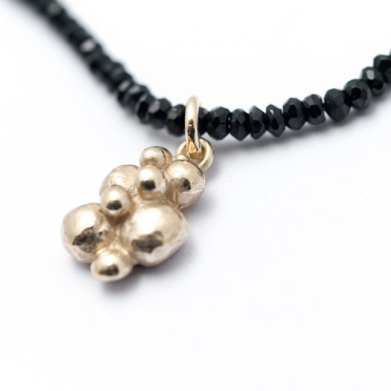 Black Spinel bead necklace with gold beaded charm
