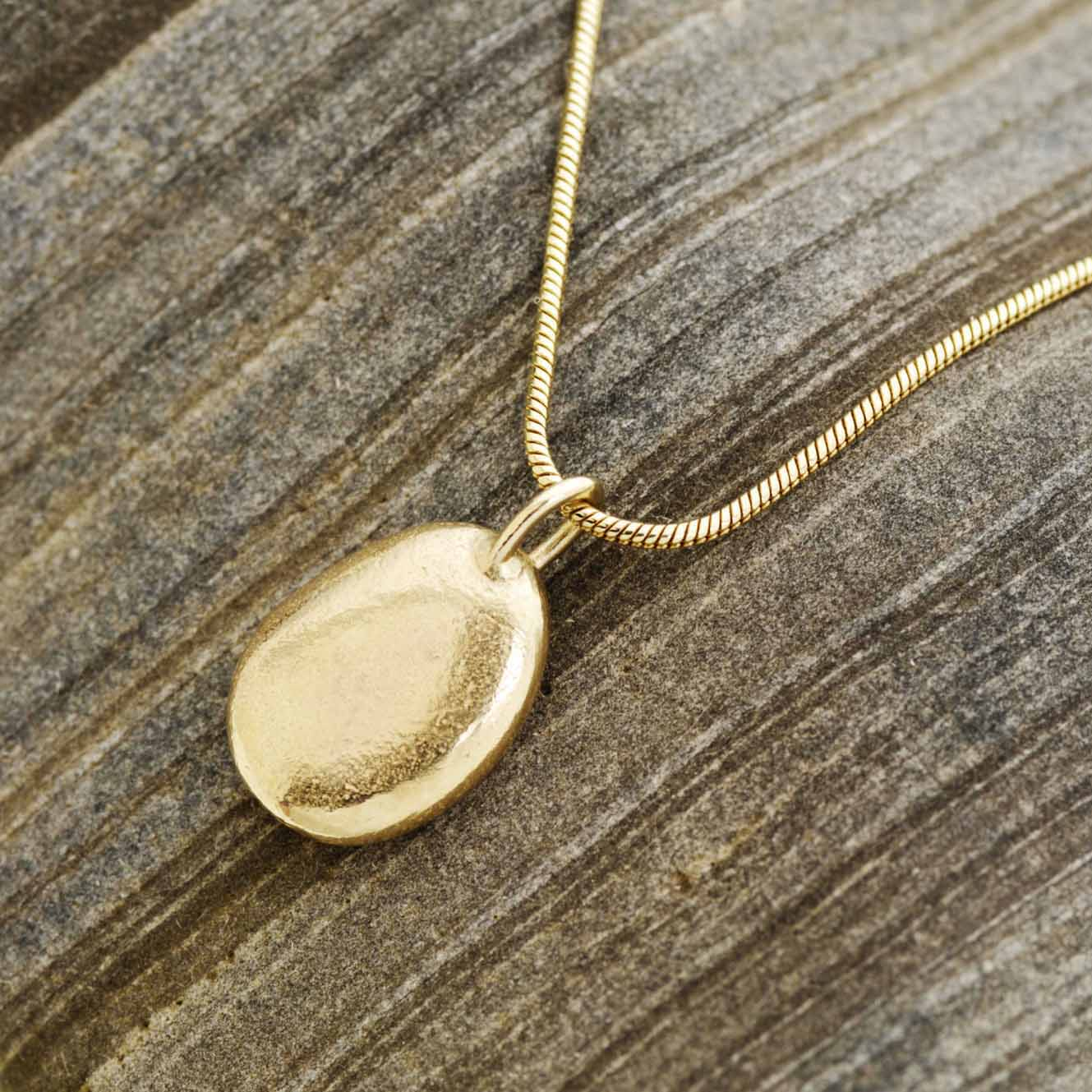 9ct gold pebble necklace alice robson jewelleryalice robson jewellery 9ct gold oval pebble necklace on snake chain aloadofball Choice Image