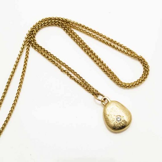 Tiny 9ct gold pebble necklace on spiga chain with a tiny 1.5mm diamond