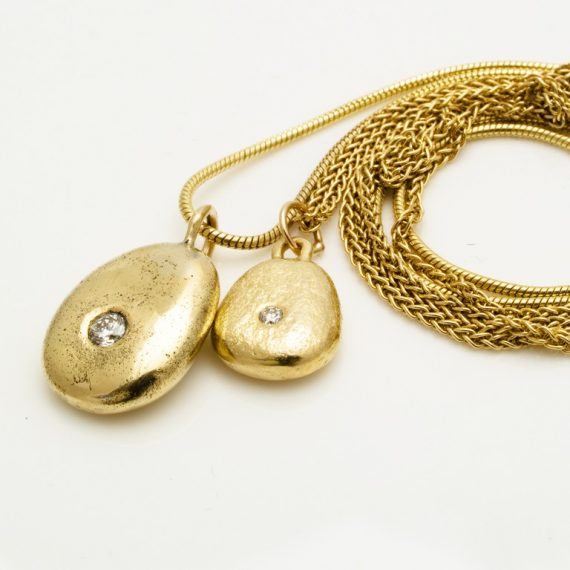 Medium and small gold pebble necklaces on 9ct chain with tiny flush set diamonds