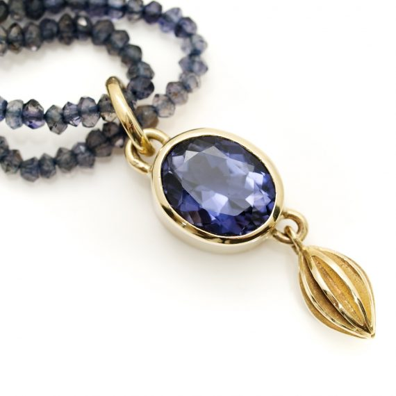 Oval Iolite facetted pendant set in 9ct gold on a double row of Iolite beads