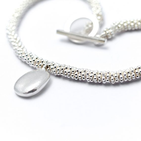 Silver bead bracelet with pebble charm