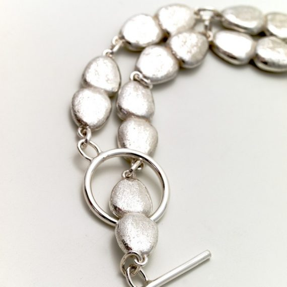 Silver continuous pebble necklace