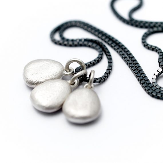 Personalised triple pebble necklace on silver oxidised chain