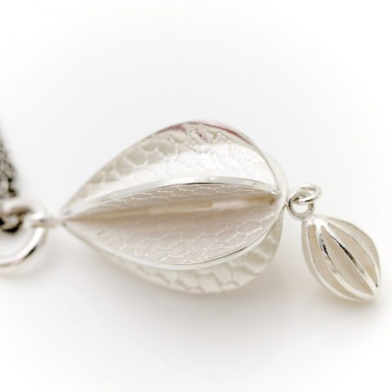 Silver constructed double pod long necklace