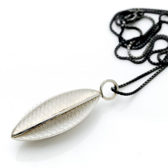 Long silver pod necklace on box chain