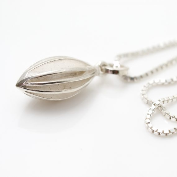 Silver medium pod drop necklace on box chain