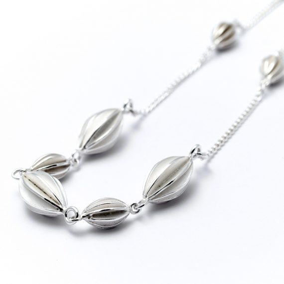 Silver semi continuous pod necklace
