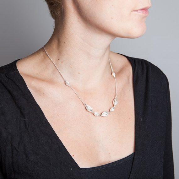Silver semi continuous pod necklace