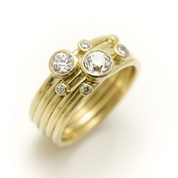 18ct yellow gold 5 band ring with scattered diamonds