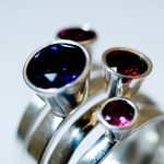 Set of 4 high stacking rings with Amethyst and Garnet