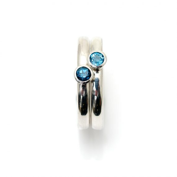part of set of narrow silver stacking rings with with Topaz