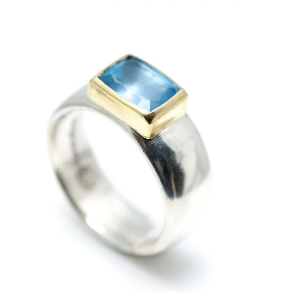 Wide silver ring with rectangular Aquamarine set in 18ct yellow gold