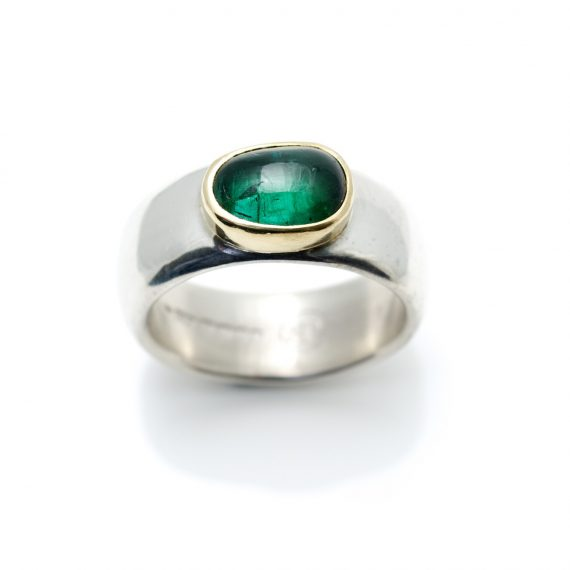 Wide silver ring with a green tourmaline set in 18ct gold