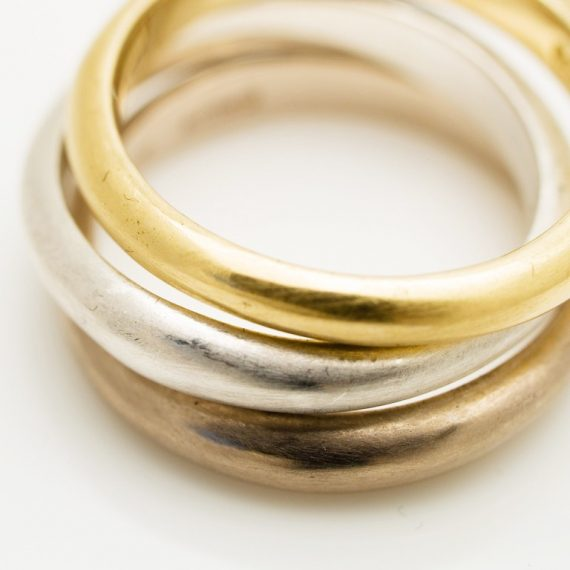 Stacking narrow wave rings in silver, 18ct yellow and 18ct white gold