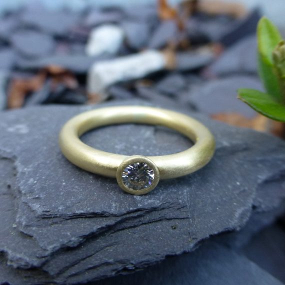 Simple gold diamond engagement ring