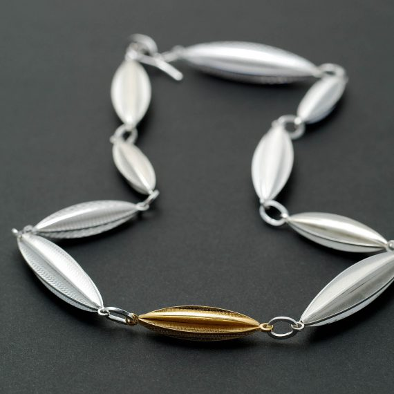 Short new continuous pod necklace with gold section