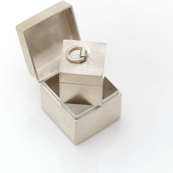Set of silver boxes including two micro box pendants