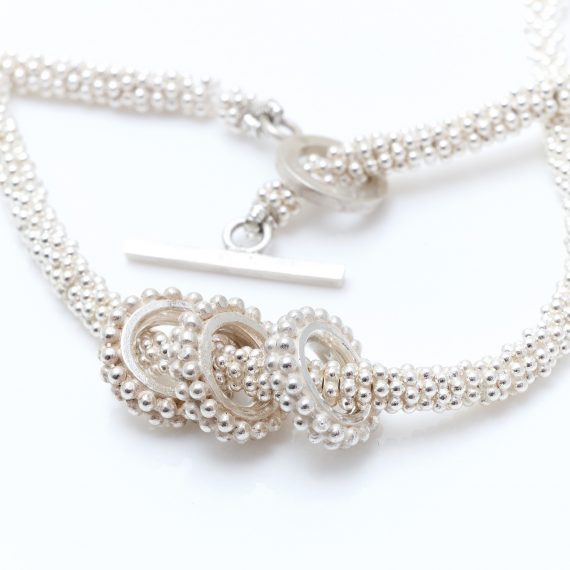 Chunky silver bead necklace with 3 beaded ring charms