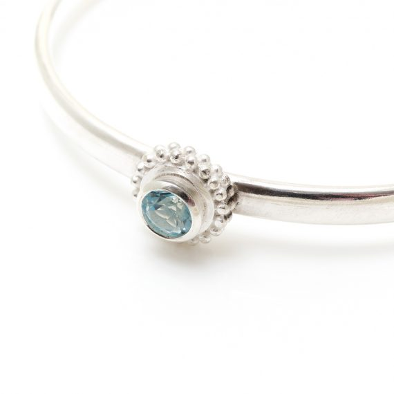 Simple silver cuff with semi precious stone and a beaded ring surround