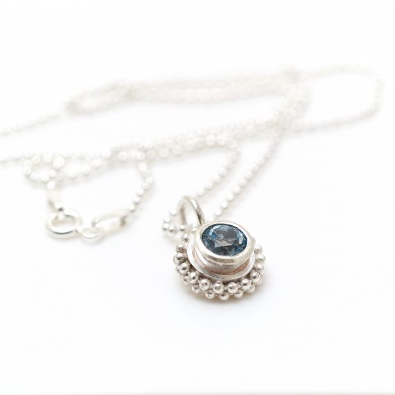 Simple silver beaded ring pendant with semi precious stone