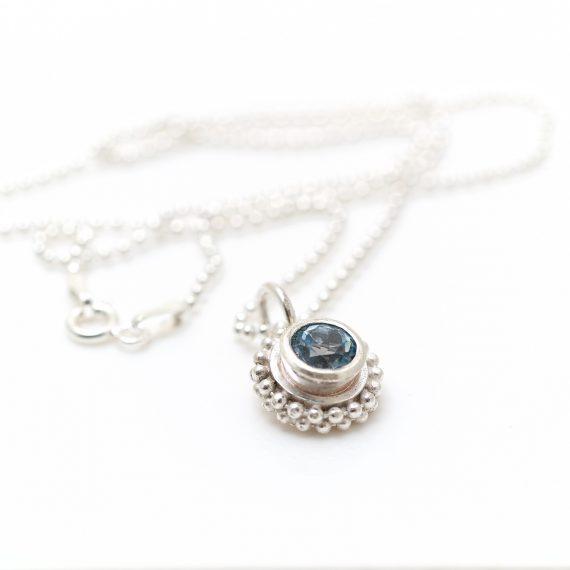 Simple silver beaded ring pendant with semi precious stone