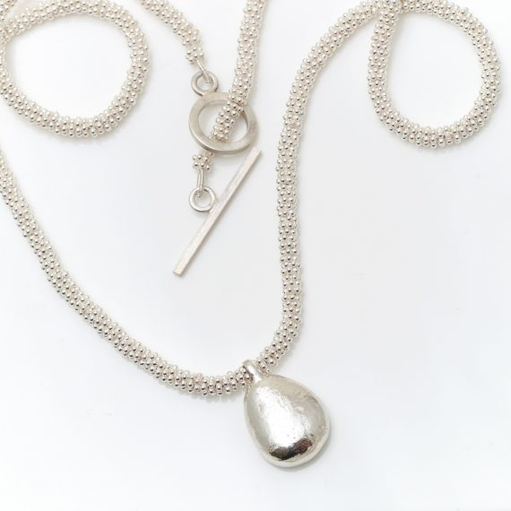 Silver Beaded necklace with chunky pebble drop