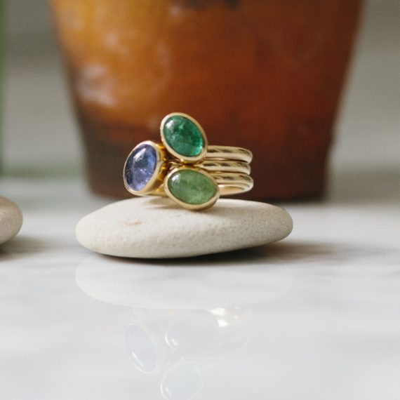 9ct gold stacking rings with garnet emerald and tanzanite