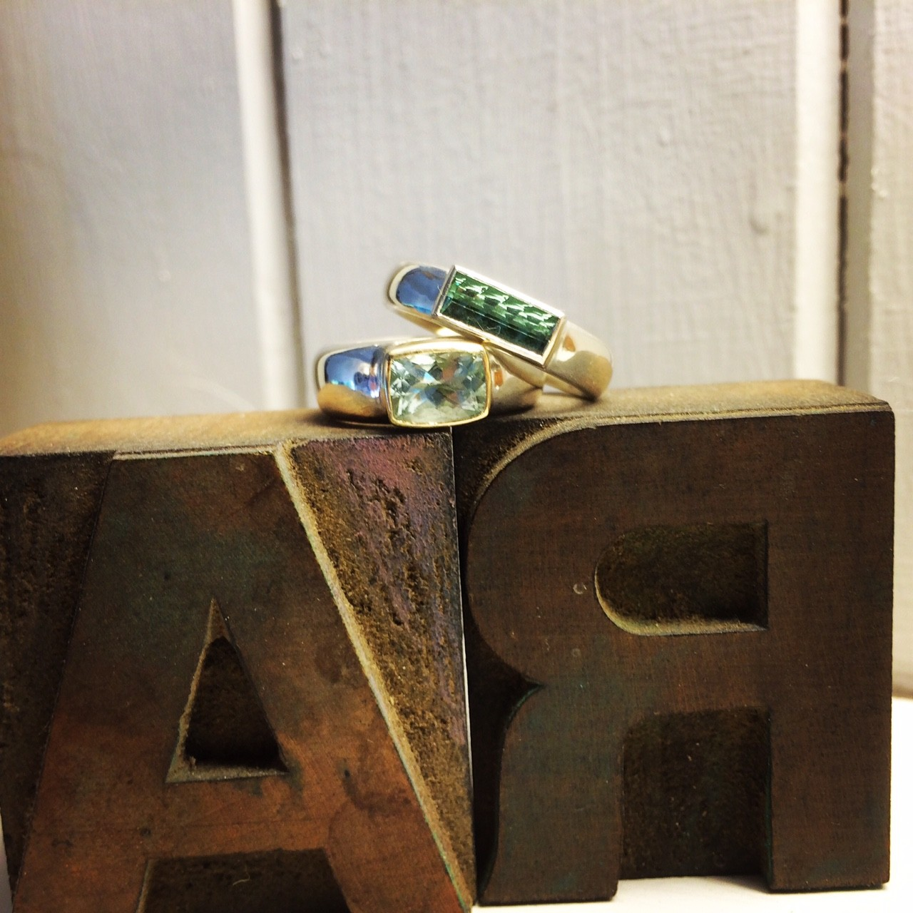 Wide silver rings with gold settings tourmaline and Aquamarine