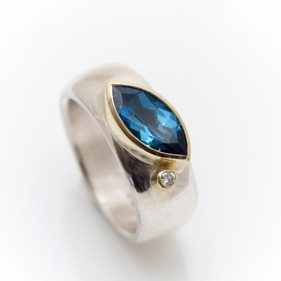 Wide silver ring with Topaz and diamond