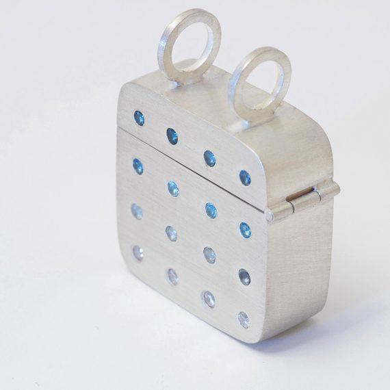 Cushion shaped box pendant with Topaz