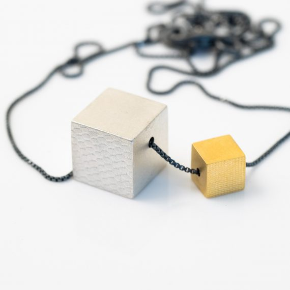 Small gold and silver cube necklace