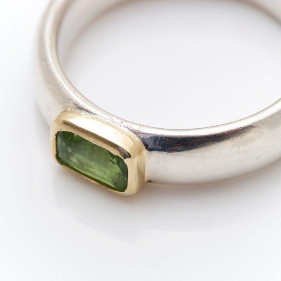 narrow chunky silver ring with rectangular peridot